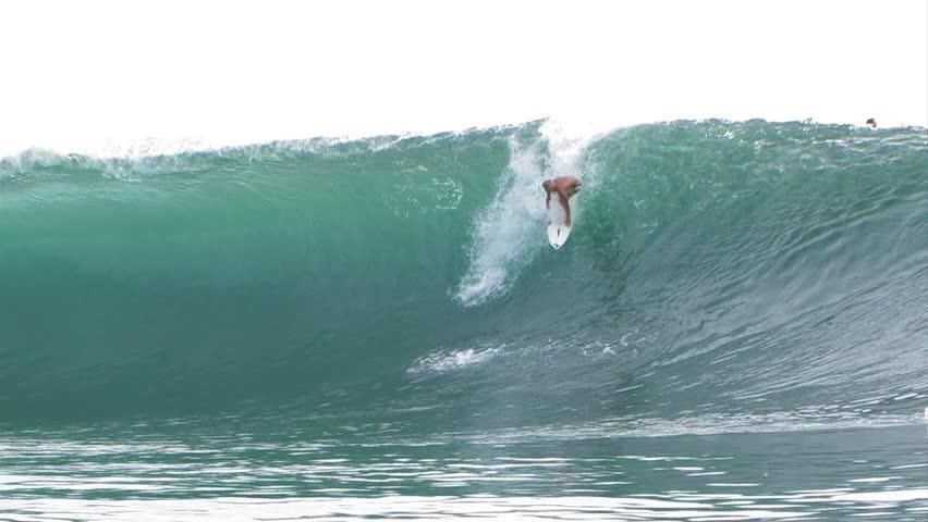 A surfer gets barreled on a big wave | Shutterstock HD Video #8100121