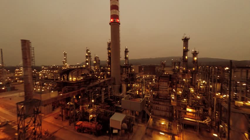 industrial background of oil and gas refinery factory. global warming simbol