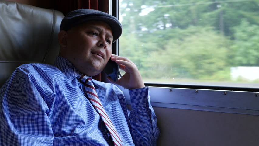Man using cellphone on train   Shutterstock HD Video #8160286