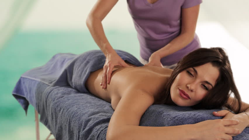 Dolly Shot Of Young Woman Having Massage Sea Background