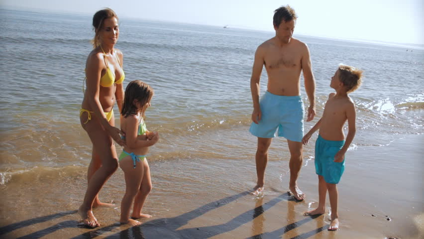 Family Playing On Beach | Shutterstock HD Video #8178871