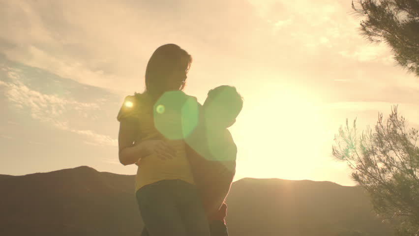 Young Couple Dancing And Twirling Overlooking Mountain In Sunset. | Shutterstock HD Video #8189941