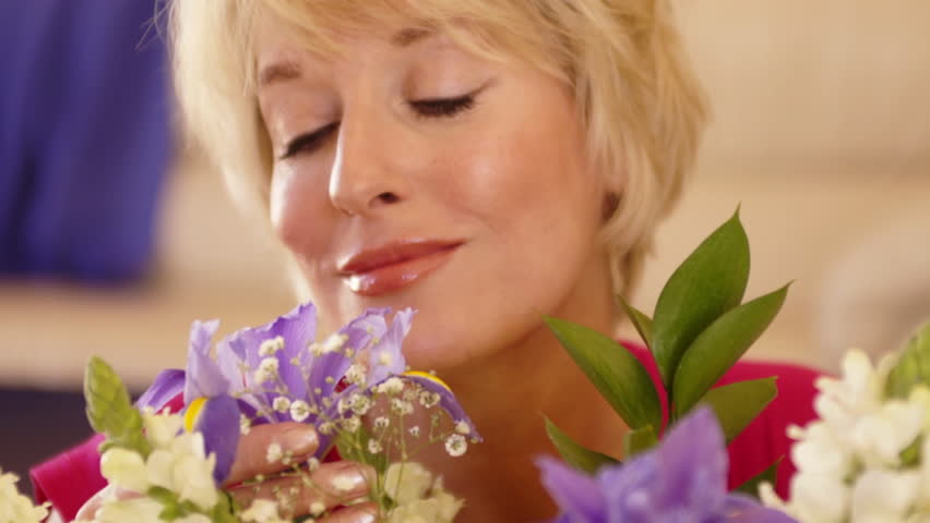 Close Up Dolly Shot Of Woman Smelling Flower Scent. #8198041