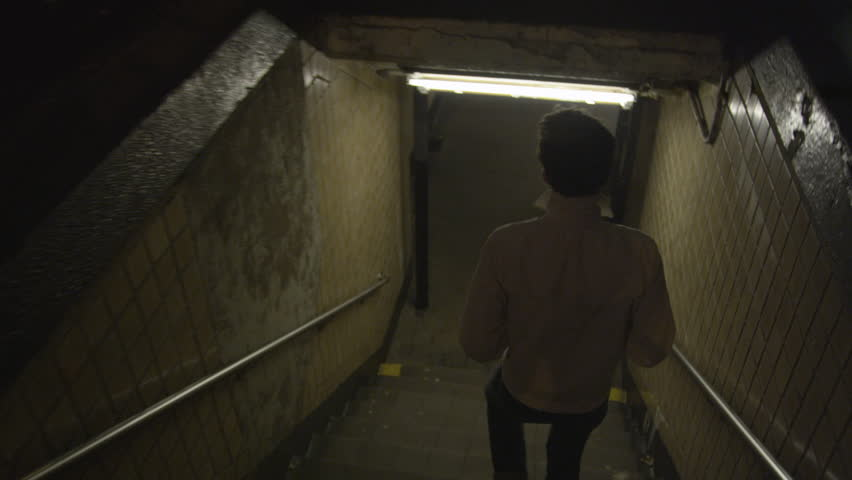Handheld, WS, ZO, TS, a young man walking down stairs and through a subway station | Shutterstock HD Video #8200231