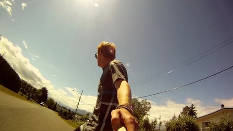 POV of a young man skateboarding down a neighborhood street. - Model Released - HD - filmed at 59.94 fps