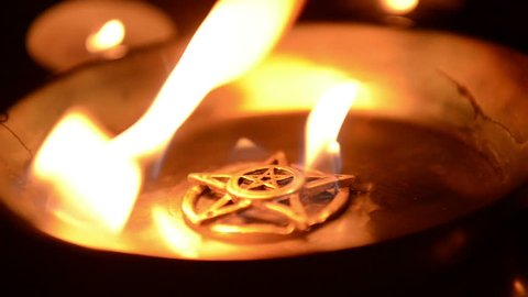 Ancient pentagram burning at altar