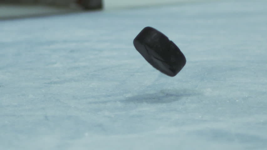 Slow Motion Hockey - Shot on Net Puck Scores Goal