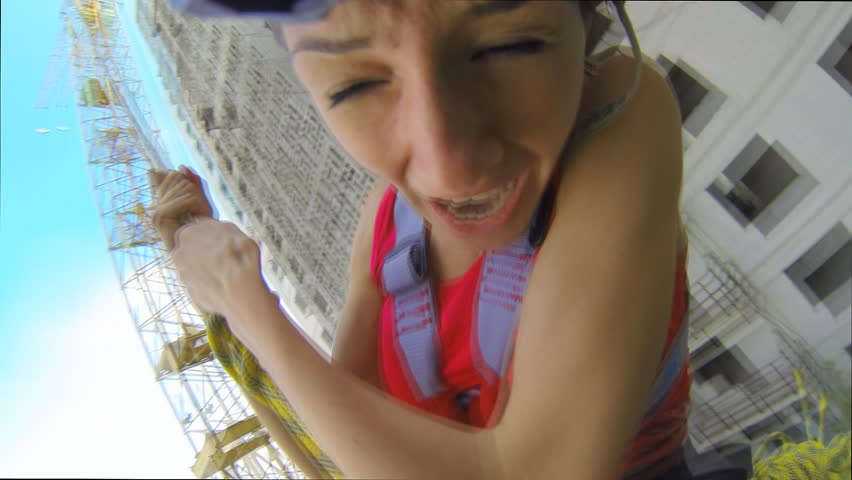 Jump from the 15th floor high-rise building with hanging 20 meters above the ground on a system of climbing ropes