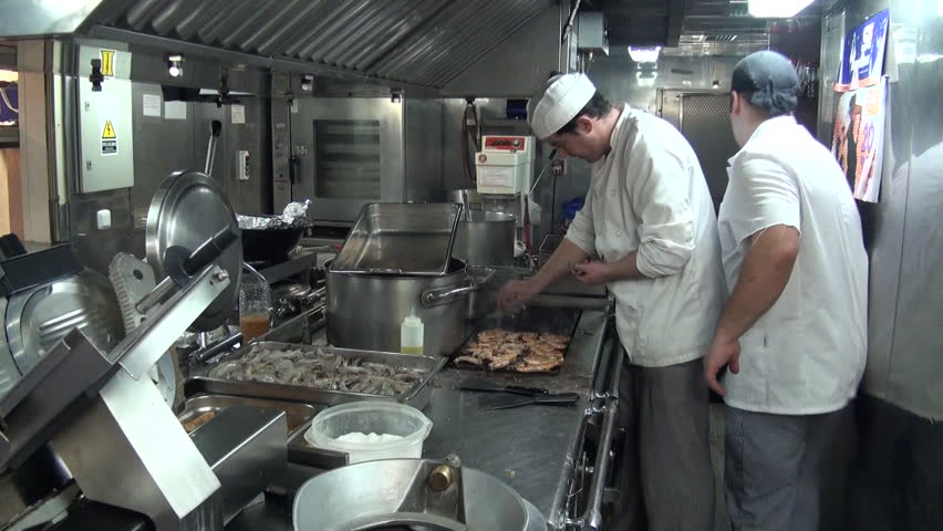B.I.O. Hespérides (A-33), Atlantic Ocean-24 December, 2010: Hesperides, A33. Chef cooking prawns   Shutterstock HD Video #8246185