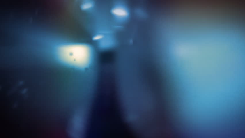 Light refracting in a rotating blue glass. Abstract background. Loop.