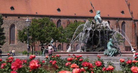 BERLIN, GERMANY - JUNE 30, 2014 Saint Mary Church Berlin Landmark People Walk Visit Neptune Fountain Park in a Sunny Day ( Ultra High Definition, UltraHD, Ultra HD, UHD, 4K, 2160P, 4096x2160 )