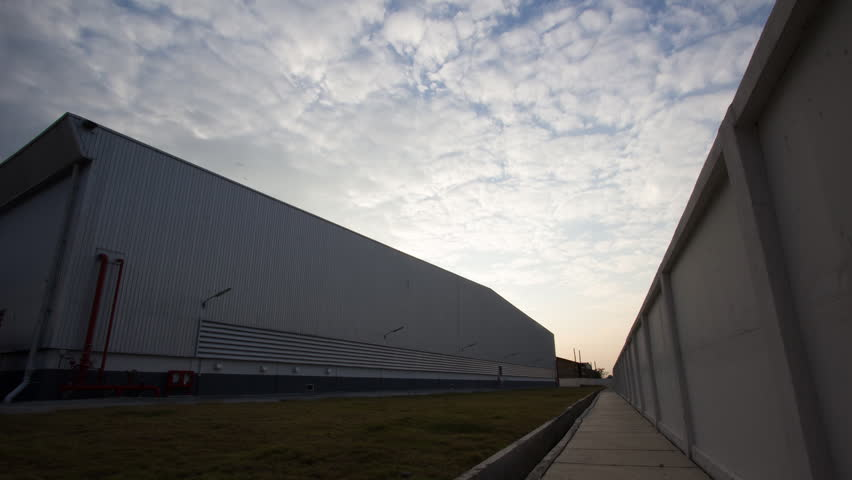 Evening skyline of warehouse. Timelapse. | Shutterstock HD Video #8294191