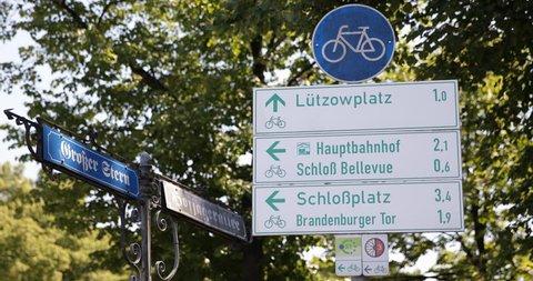 Berlin City Center Central Square Grosser Stern Urban Road Sign Focus on Crossroad Board - Version 1 ( Ultra High Definition, UltraHD, Ultra HD, UHD, 4K, 2160P, 4096x2160 )