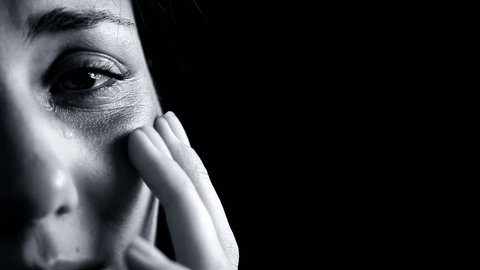 Black and white portrait of woman crying after domestic violence closeup