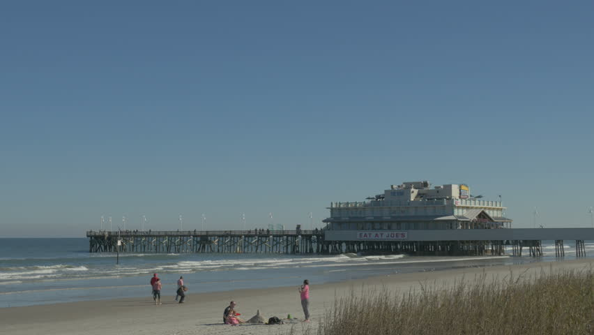 Daytona Beach Florida December 14 Family Building A Sandcastle On The Near Pier Fall Day 2017 In