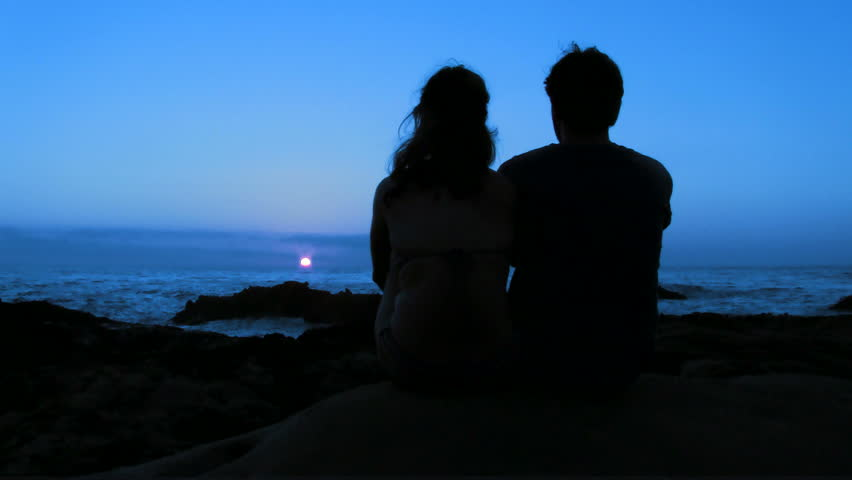 Romantic couple by ocean at sunset V1 - HD