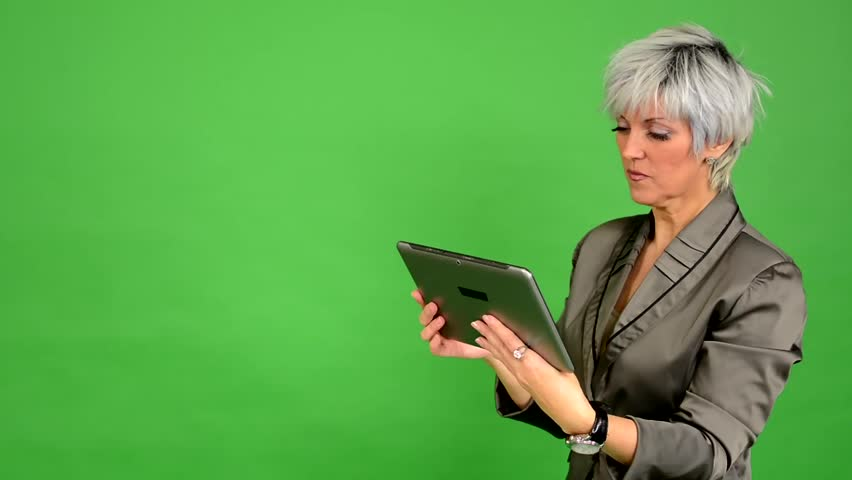 Business middle aged woman works on tablet - green screen - studio | Shutterstock HD Video #8327101