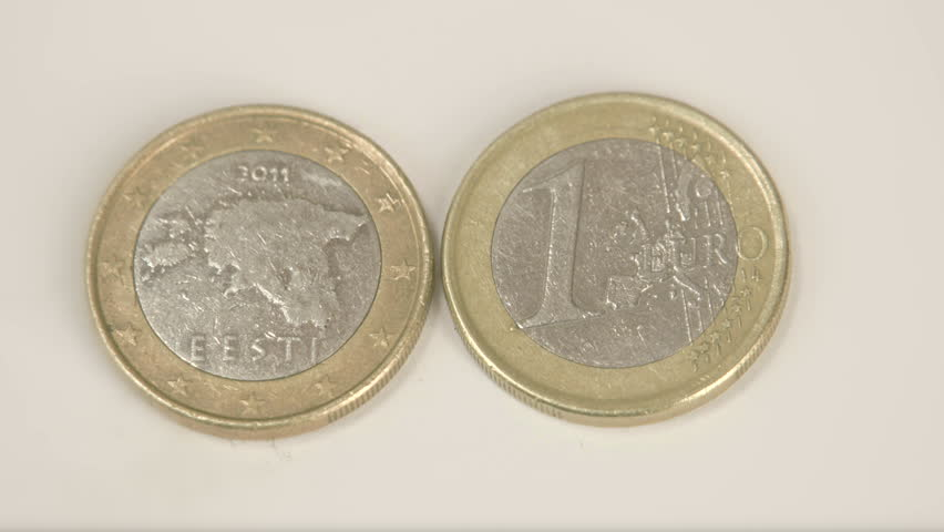An Estonian 2011 coin and a 1 Estonia Euro coin. The first coin has a text of Eesti as back detail and the other coin is a 1 Euro coin | Shutterstock HD Video #8349178