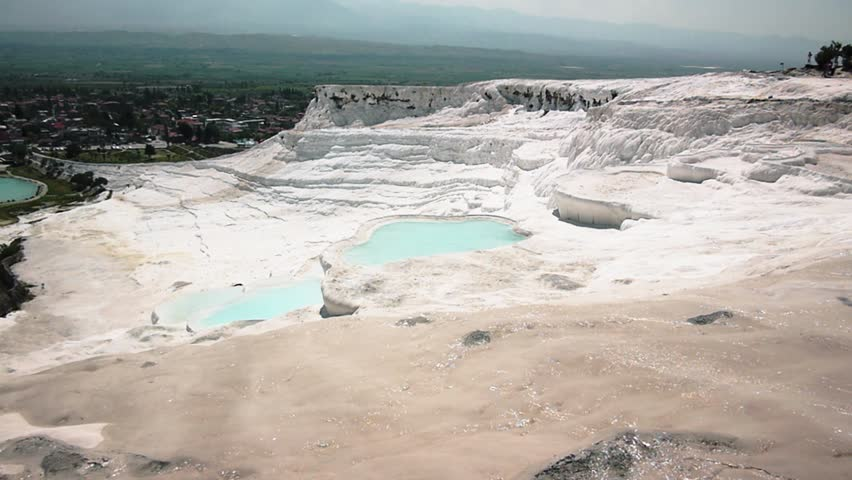 Travertines with blue water in Pamukkale, Turkey