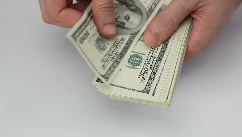 Counting Many 100 Us Dollars Bank Notes By Hand