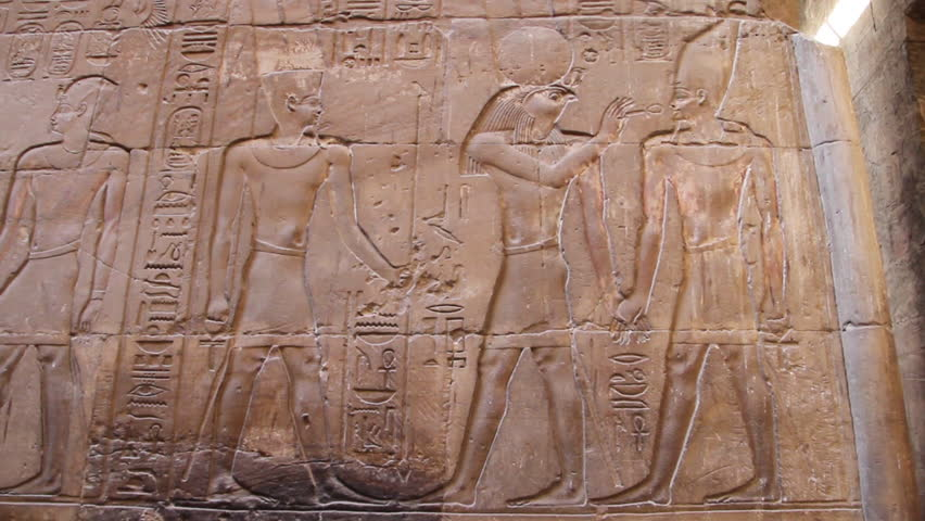 Ancient Egyptian hieroglyphics. Pan left. Shot at Luxor Temple in Luxor, Egypt. 1080p HD.