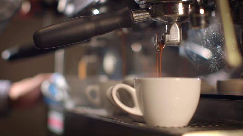 Preparing cups of espresso at a busy coffee shop #8494246