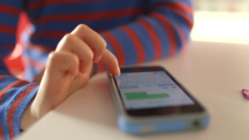 Young girl sms texting on a smartphone device   Shutterstock HD Video #8516761