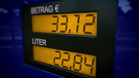 Slow zoom in motion of German gas pump display starts fueling at 36 Euros