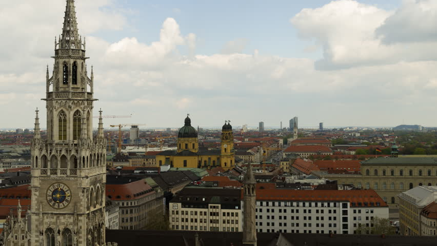 Timelapse with panoramic view of Munich city center showing the City Hall and the Frauenkirche, Germany