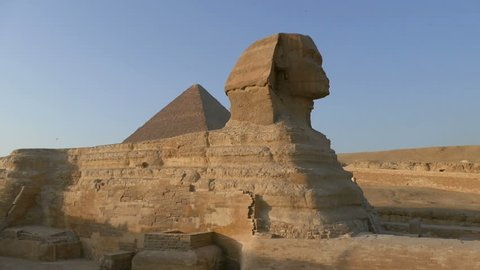 famous ancient Sphinx and Cheops pyramid in Giza Cairo Egypt - pan