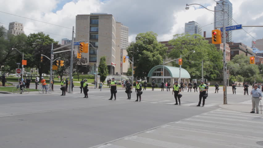 TORONTO, ONTARIO - JUNE 24th: Police line University Avenue on June 24th, 2010, Toronto, Ontario, Canada. Approximately 10,000 uniformed police officers were deployed during the G20 summit in Toronto.