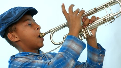 African boy blowing cheeks playing the trumpet