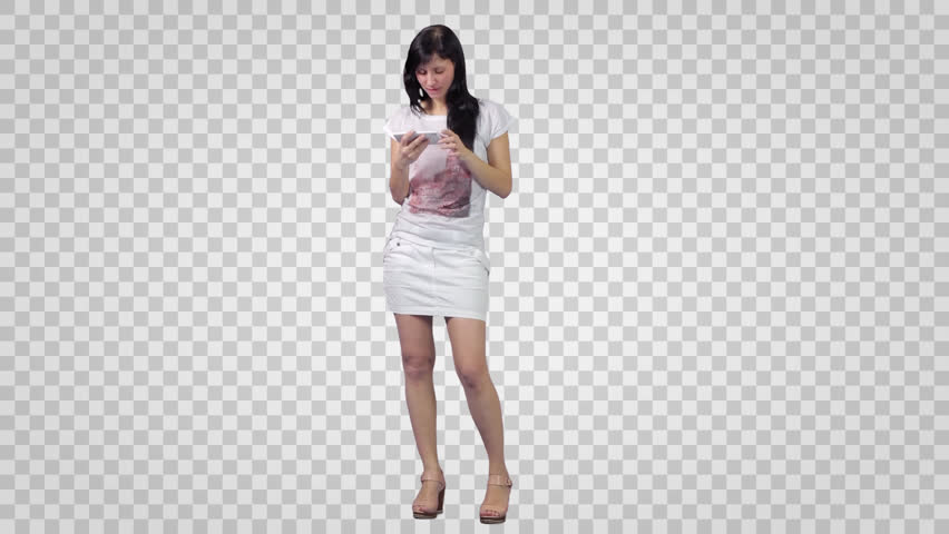Brunette girl in white short skirt watching smartphone. Footage with alpha channel.