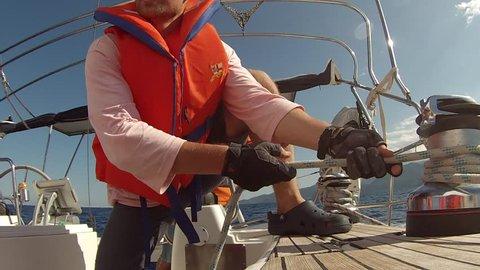 ZAKYNTHOS, GREECE - CIRCA OCT, 2014: Clips set: Sailors participate in sailing regatta 12th Ellada Autumn 2014 among Greek island group in the Ionian Sea and Aegean Sea, in Cyclades and Saronic Gulf.