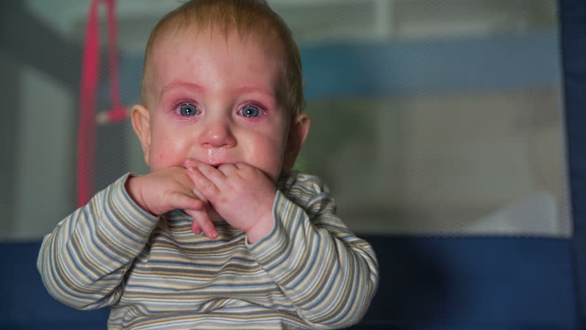 918acffe8 Children with tears in his eyes. Small blue eyes baby boy with tears in his  eyes and putting hi hands in his mouth the footage is recorded in slow  motion in ...