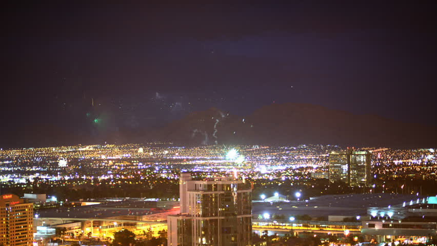 4K Time lapse footage with tilt down motion of fireworks in Las Vegas on July 4th | Shutterstock HD Video #8710591