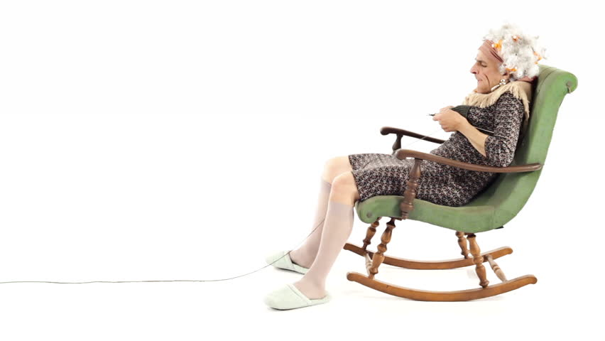 Old Woman Knitting In A Rocking Chair