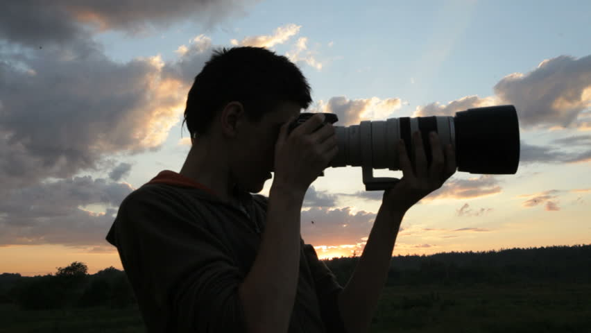 Boy With A Camera At Sunset - Silhouette Stock Footage Video ...