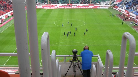 RUSSIA, MOSCOW - NOV 02, 2014 (Time Lapse): Operator shoots video of football match on the field of Locomotive sports arena in Cherkizovo.