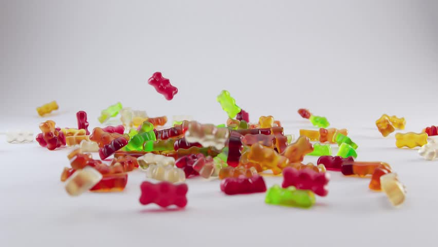 Colorful gummy bears falling in slow motion full HD footage