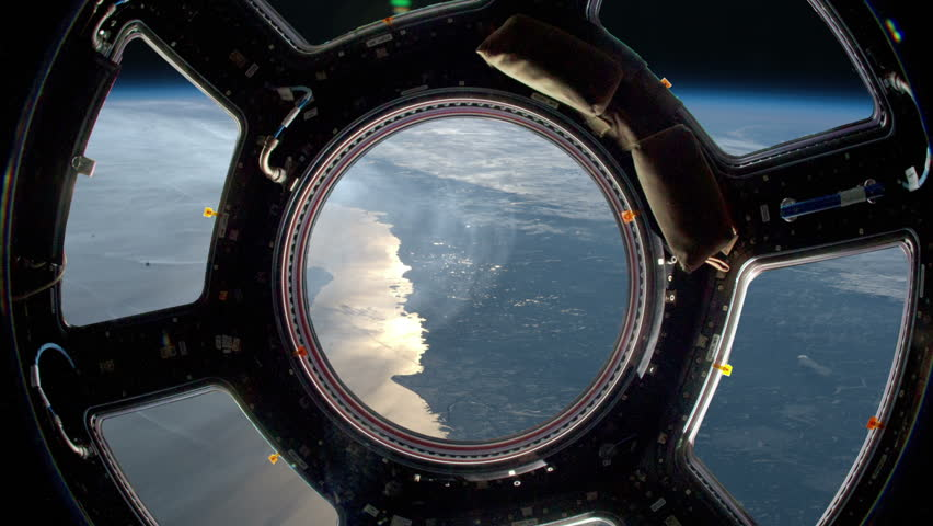 Earth as seen through window of International Space Station (ISS). Perfect of computer graphics videos about: space, earth, orbit, ISS, the International Space Station, astronauts, NASA and discovery
