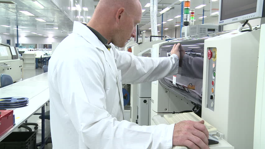 Operator at automated electronics parts manufacturing line jib up