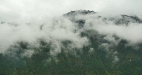 4k time lapse of mountain mist rising in the morning,fog pine trees,such as wonderland.Bomi County in tibet,the largest precipitation area in China. gh2_09895_4k