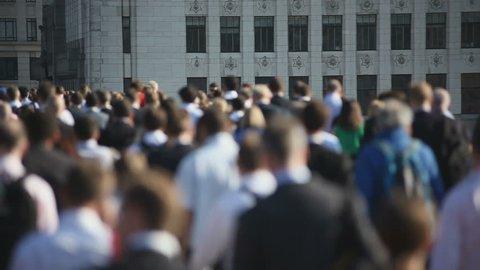 Hi-mo large crowd of pedestrians walk over London Bridge 02