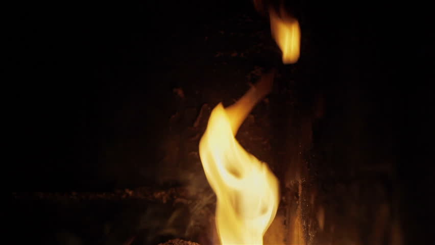 Fire in fireplace yellow flames close-up. Hygge concept - living well and living simply, warm atmosphere in cozy home, family mood #8863261