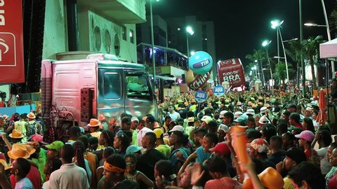SALVADOR, BRAZIL - FEBRUARY 7, 2015: Crowd partying around the Trio Eletrico (music truck with sound system and band performing on the roof) at Carnival 2015 in Salvador, Bahia, Brazil.