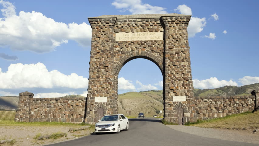 Time lapse shot of the historic stone archway entrance in Yellowstone National Park