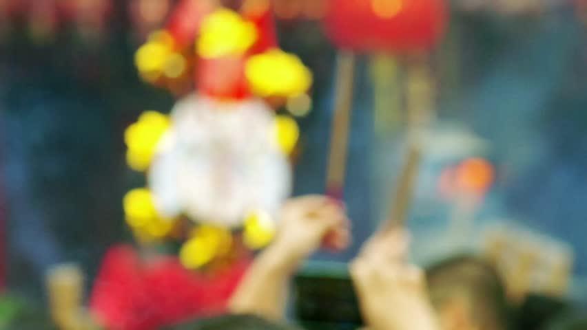 HONG KONG, CHINA - CIRCA Feb 2015 - Wong Tai Sin Temple in Hong Kong during chinese new year. People worships with burning incense. | Shutterstock HD Video #8940538