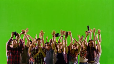 4K Crowd of fans and paparazzi on green screen. Dancing, photo shooting, Slow motion. Shot on RED EPIC Cinema Camera.