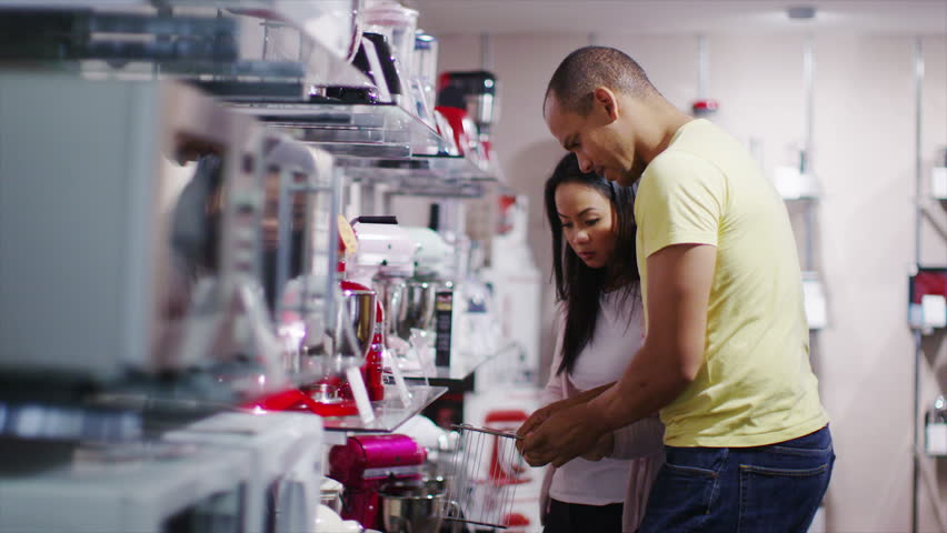 4K Couple shopping in a store selling kitchen appliances, white goods & electronics | Shutterstock HD Video #8983831
